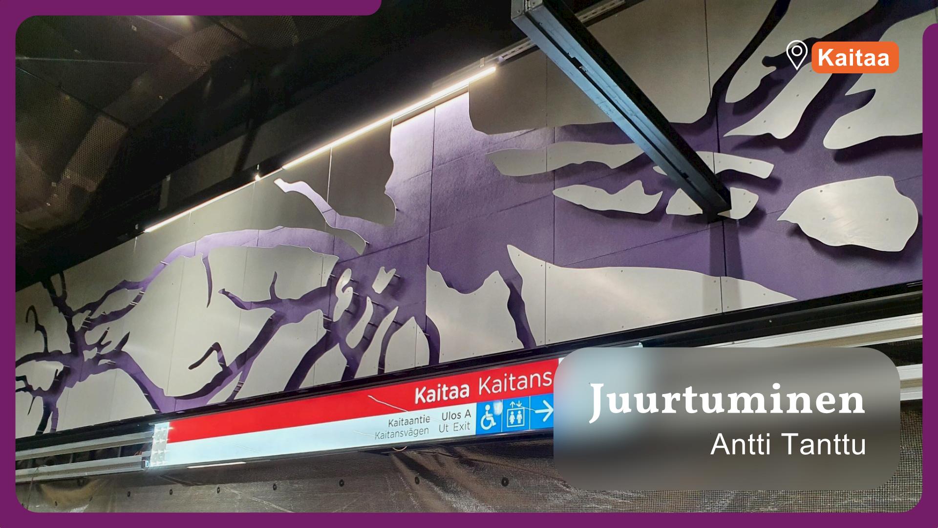 Kuvassa näkyy Antti Tantun Juurtuminen-teoksen juuria metrolaiturin seinässä.